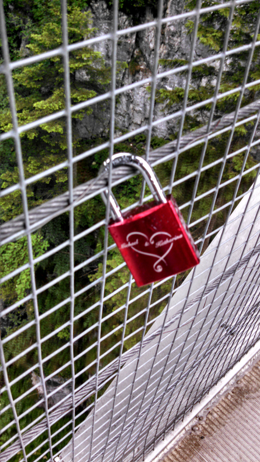Here is a tradition that Spencer noticed in Paris last year:  lovers lock a padlock on a fence or something like that.
