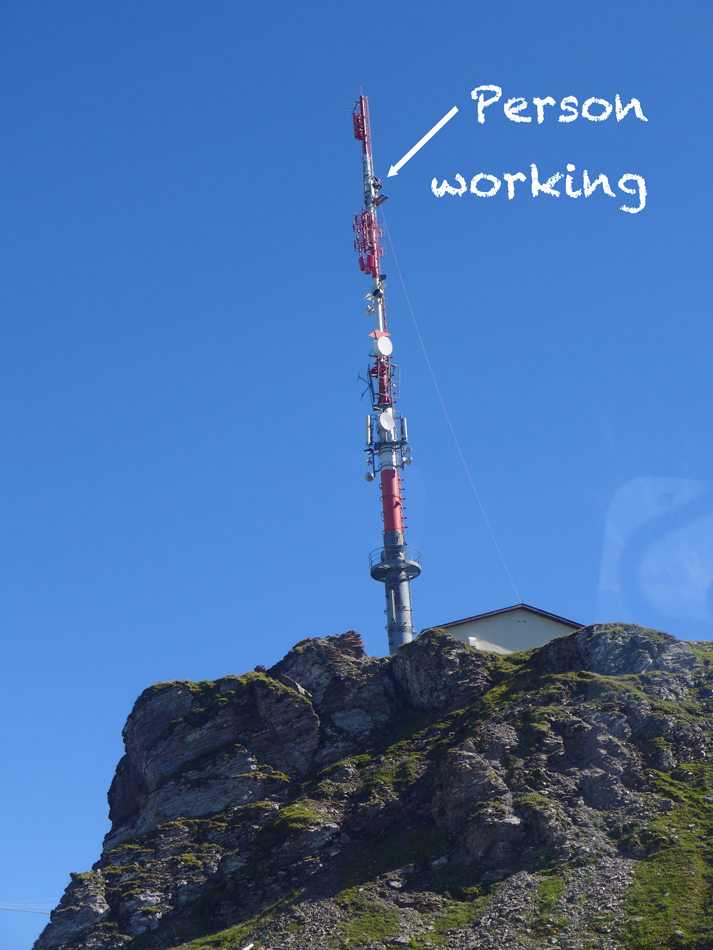 This tower is at the top of the mountain.  Peter noticed that someone was working up near the top.