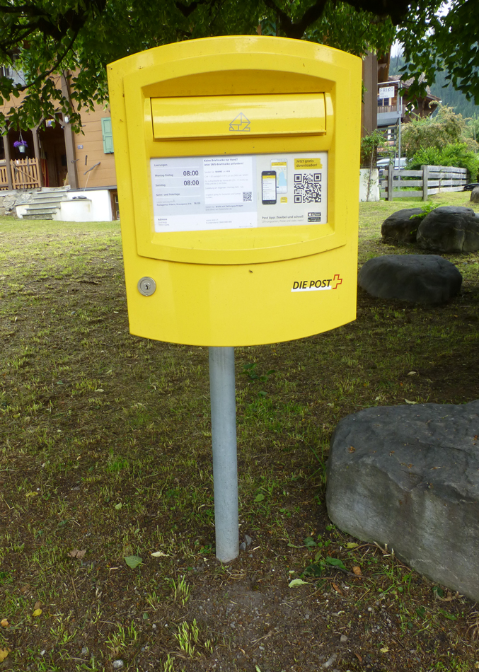 Neato -  a post box with a QR code.