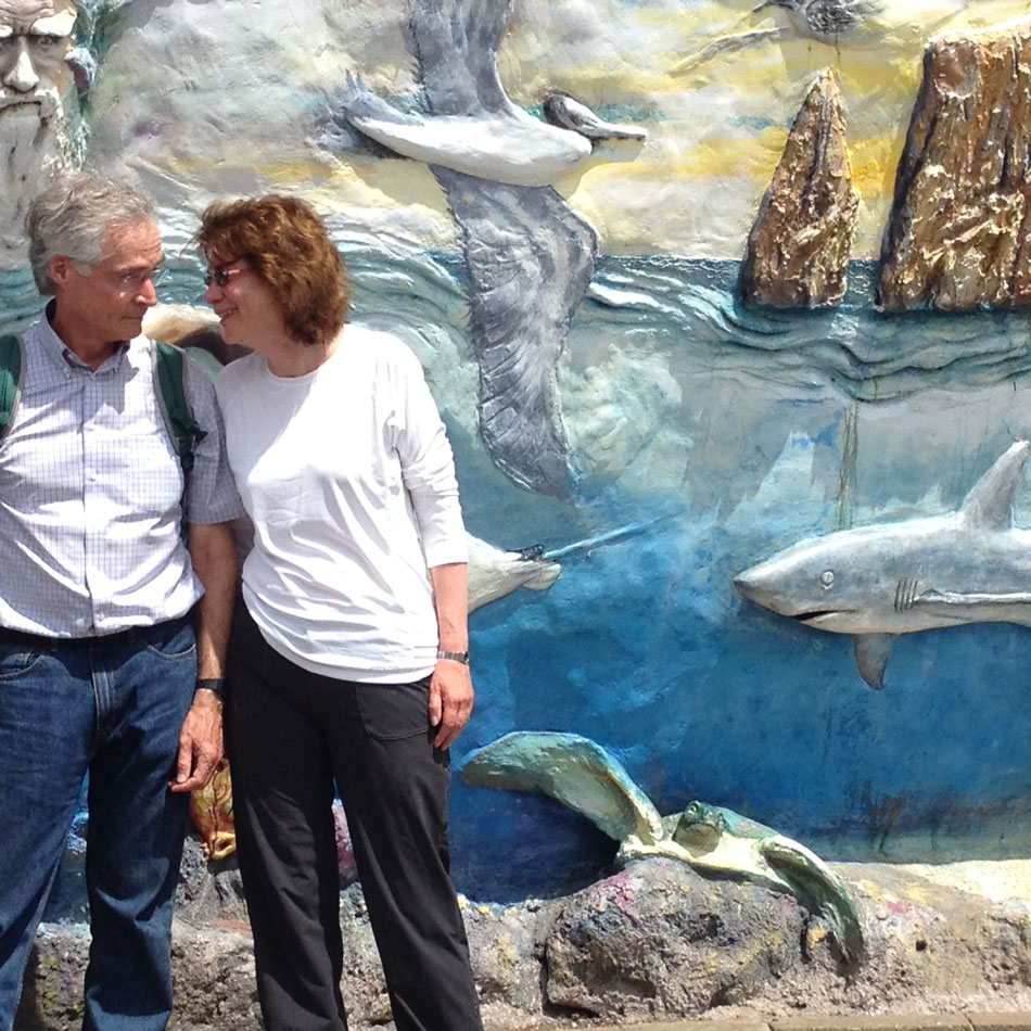 The two of us in front of a cute mural