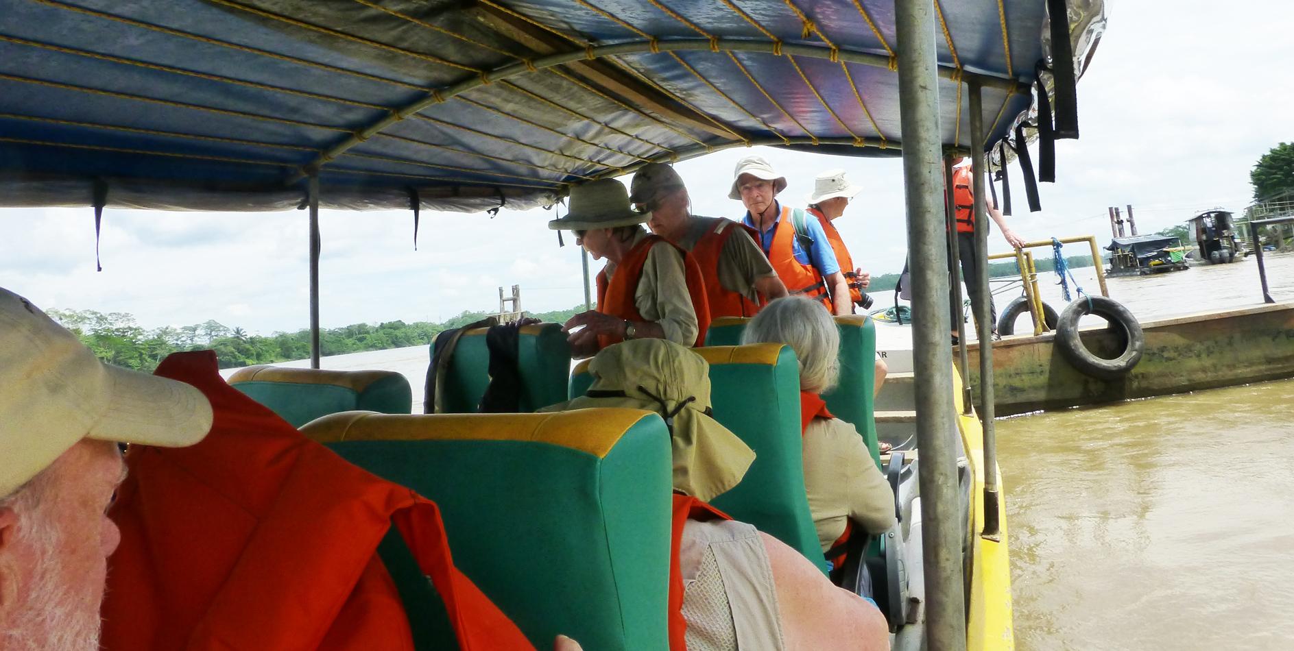 Boarding the motorized canoe